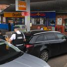 Police at the scene of an attempted ATM theft at a Topaz filling station on the Gilnahirk Road in Belfast. Photo By Justin Kernoghan