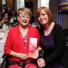 Lyra's sister Nichola Corner and mum Joan McKee with her award.