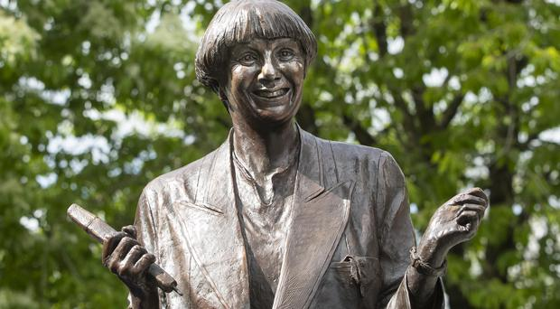 The life-size bronze statue of the late comedian, writer and actor, Victoria Wood in Bury town centre (Danny Lawson/PA)