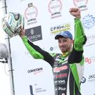 Glenn Irwin celebrates winning the Anchor Bar Superbike race at the North West 200 (Stephen Davison/Pacemaker Press)