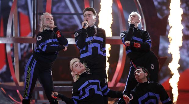 """Hatari of Iceland perform the song """"Hatrio mun sigra"""" during the 2019 Eurovision Song Contest grand final rehearsal in Tel Aviv, Israel, Friday, May 17, 2019. (AP Photo/Sebastian Scheiner)"""