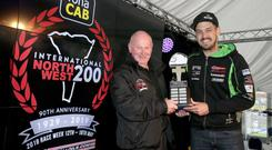 James Hillier receives his man of the meeting award from Events Director Mervyn Whyte MBE.