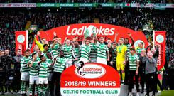 Celtic players celebrate with the trophy after winning the Ladbrokes Scottish Premiership match at Celtic Park, Glasgow. Photo credit: Jane Barlow/PA Wire.