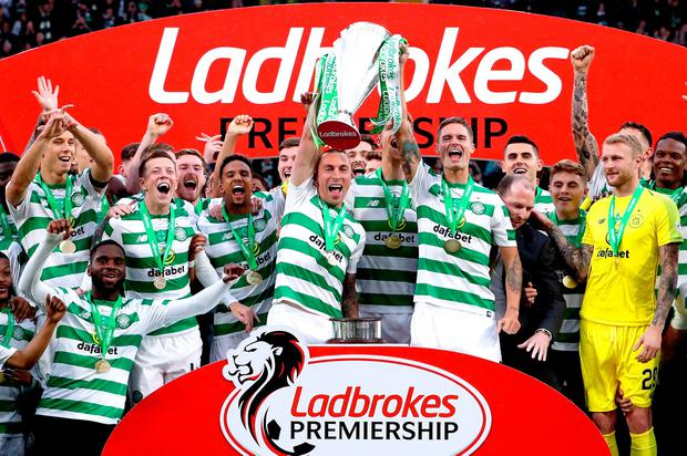 Celtic's Scott Brown (centre) and Mikael Lustig celebrate with the trophy after winning the Ladbrokes Scottish Premiership match at Celtic Park, Glasgow. Photo credit: Jane Barlow/PA Wire.