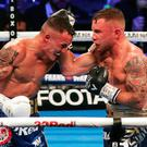 Brave effort: Carl Frampton (far right) during his defeat to world champion Josh Warrington