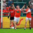 Hot shot: Armagh's Mark Shields celebrates his goal against Down yesterday