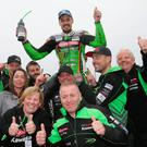 Top man: James Hillier celebrates victory following the CP Hire Superstock race at the North West 200