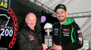 Main man: James Hillier receives his Man of the Meeting award from North West 200 event director Mervyn White