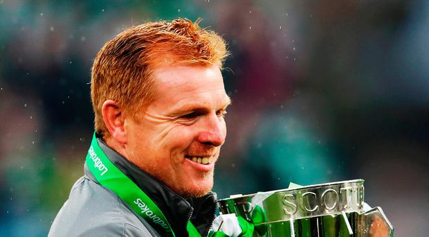Proud man: Celtic interim boss Neil Lennon with the Scottish Premiership trophy at Parkhead yesterday