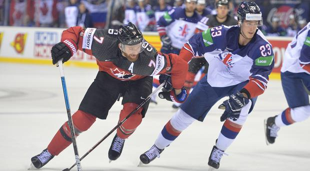 Paul Swindlehurst in action against Canada's Sean Couturier at the IIHF Ice Hockey World Championships in Kosice, Slovakia (Dean Woolley/MB Media/Getty Images)
