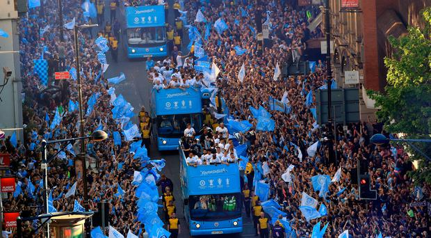 Lapping it up: Man City hold an opentop bus parade that drew 100,000 fans