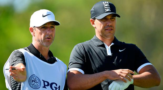 Top team: Ricky Elliott with Brooks Koepka at the US PGA Championship at Bethpage