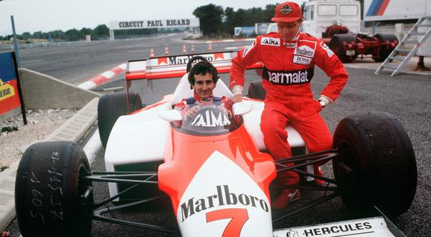 (FILES) In this file photo taken on November 14, 1983, French Formula One driver Alain Prost (L) poses with Austrian former champion Niki Lauda on the McLaren car they will drive during the 1984 Formula One season at Le Castellet racetrack, southern France. - Legendary Formula One driver Niki Lauda has died at the age of 70, his family said in a statement released to Austrian media early Tuesday, May 21, 2019. (Photo by GERARD FOUET / AFP)GERARD FOUET/AFP/Getty Images