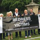 Survivors of institutional abuse stage protest outside garden party hosted by Secretary of State Karen Bradly in Enniskillen. Pic Ben Tucker