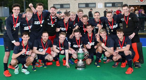 Lisnagarvey players celebrate getting their hands on the Anderson Cup.