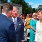 The Prince of Wales meeting guests at a garden party at Castle Coole in Enniskillen, Co. Fermanagh. Liam McBurney/PA Wire