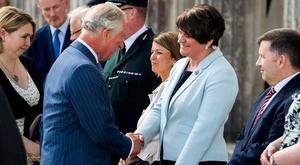 The Prince of Wales is greeted by DUP leader Arlene Foster as the Secretary of State for Northern Ireland Karen Bradley (left) and UUP leader Robin Swann (right) look on, during the Prince's visit with the Duchess of Cornwall, for a garden party at Castle Coole in Enniskillen, Co. Fermanagh.
