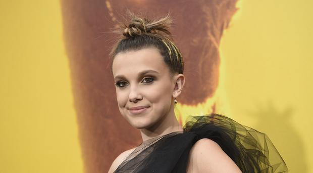 Stranger Things star Millie Bobby Brown has opened up on how bullies forced her to switch schools (Chris Pizzello/Invision/AP)