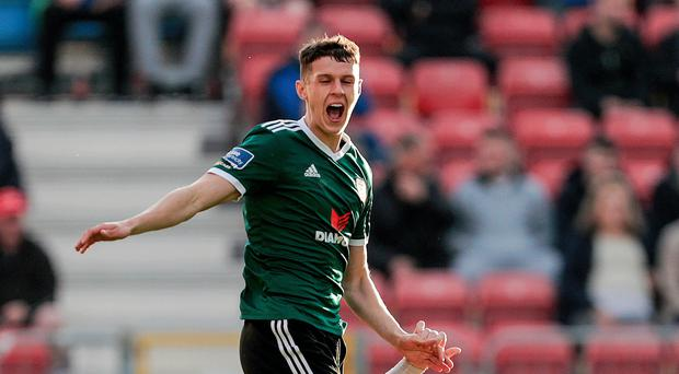 Held up: St Pat's Gary Shaw tackles Eoin Toal of Derry City