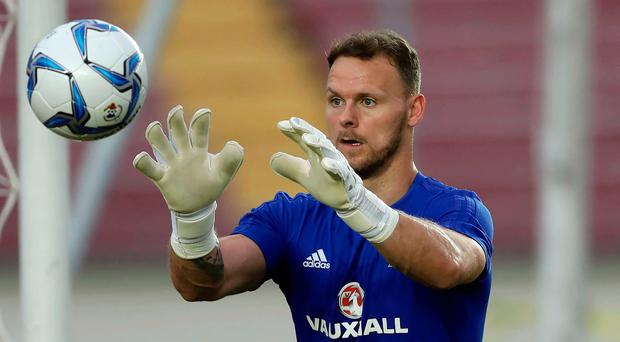 In hand: Trevor Carson is delighted to be a part of NI's training camp in Manchester