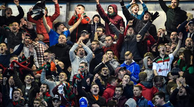 Irish League supporters are divided over a potential switch to summer football.