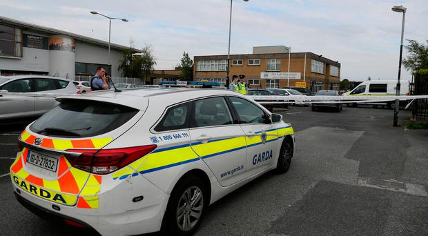 Members on An Garda at the scene in the Marigold Road area of Darndale as a second man has been shot in Dublin in less than 24 hours. Brian Lawless/PA Wire