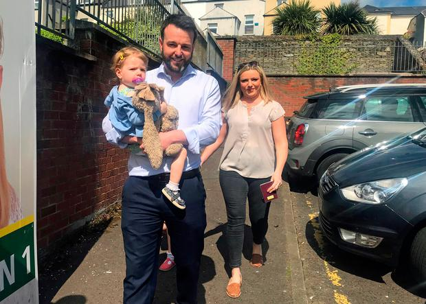 SDLP Leader and MEP candidate Colum Eastwood arrives with his wife Rachael and their two daughters to vote in Londonderry, Northern Ireland, as voters head to the polls for the European Parliament election. PRESS ASSOCIATION Photo. Picture date: Thursday May 23, 2019. See PA story POLITICS Elections Ulster. Photo credit should read: Aoife Moore/PA Wire