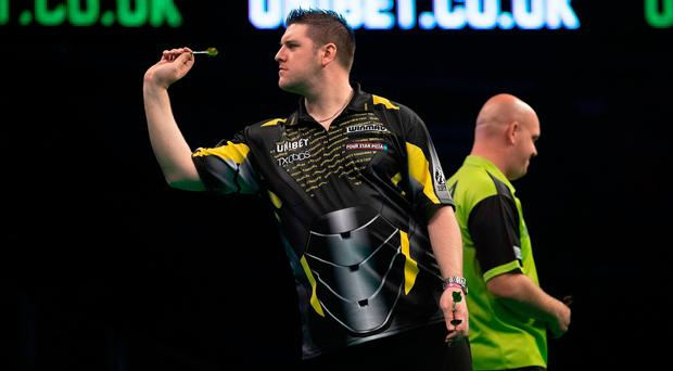 On throw: Daryl Gurney during his defeat to Michael van Gerwen in London