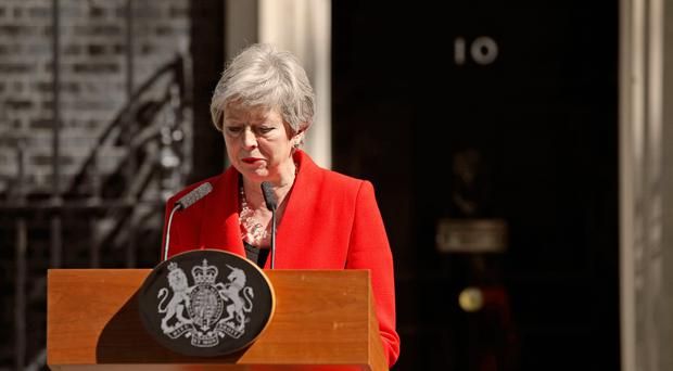 Prime Minister Theresa May makes a statement outside at 10 Downing Street in London. Photo credit: Yui Mok/PA Wire