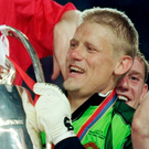 Champions: Sir Alex Ferguson and Peter Schmeichel lift the Champions League trophy to complete the Treble