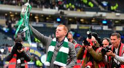 Neil Lennon, manager of Celtic poses with the Scottish Cup at the final whistle during the Scottish Cup Final between Heart of Midlothian FC and Celtic FC at Hampden Park on May 25, 2019 in Glasgow, Scotland. (Photo by Mark Runnacles/Getty Images)