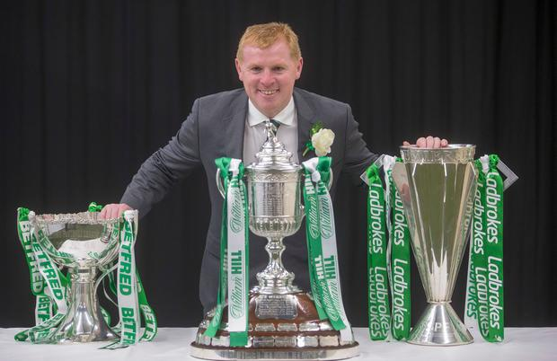 Celtic Manager Neil Lennon with the Treble of Scottish trophies during the William Hill Scottish Cup Final at Hampden Park, Glasgow. Pic: Jeff Holmes/PA Wire.