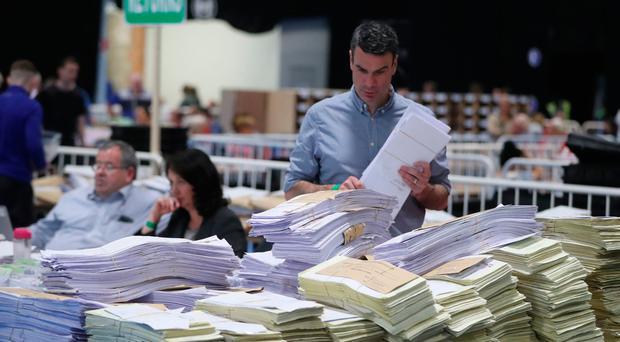 Ballot boxes are opened and counting begins in the Local and European Elections and divorce referendum at the RDS in Dublin. Pic: Niall Carson/PA Wire