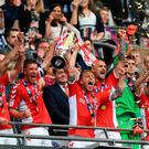 Jason Pearce of Charlton Athletic and Chris Solly of Charlton Athletic lift the trophy following their victory and promotion in the Sky Bet League One Play-off Final match between Charlton Athletic and Sunderland at Wembley Stadium on May 26, 2019 in London, United Kingdom. (Photo by James Chance/Getty Images)