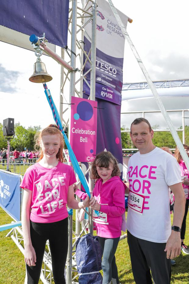Bangor girls Harriet (13) and Genevieve Graham (6) and their father Peter from Bangor rang the bell to start this year's Cancer Research UK's Race for Life, at Stormont Estate. Their mother Lisa died from a rare form of kidney cancer in 2016. Runners of all abilities took part in the 5k and 10k events.