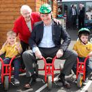 IEF campaign chair Baroness May Blood with hotelier John Fitzpatrick and Omagh IPS children Jake and Daniel at the opening of the school's new children's centre
