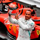 Salute: Lewis Hamilton reveals helmet tribute to late Niki Lauda after winning the Monaco Grand Prix yesterday