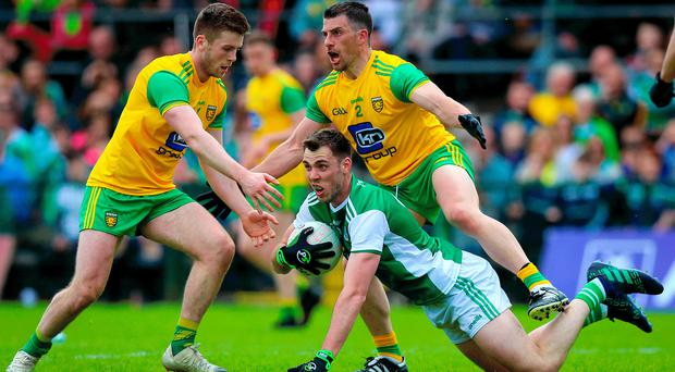 Crowded out: Eoghan Ban Gallagher and Paddy McGrath surround Fermanagh's Ryan Jones as Donegal came out on top at Brewster Park