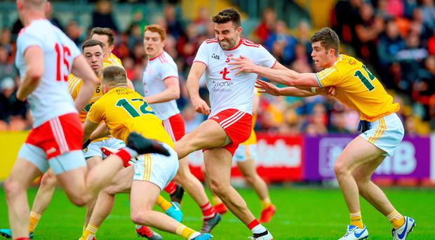 Finisher: Tyrone's Tiernan McCann scores a goal during Saturday night's victory over Antrim in Armagh