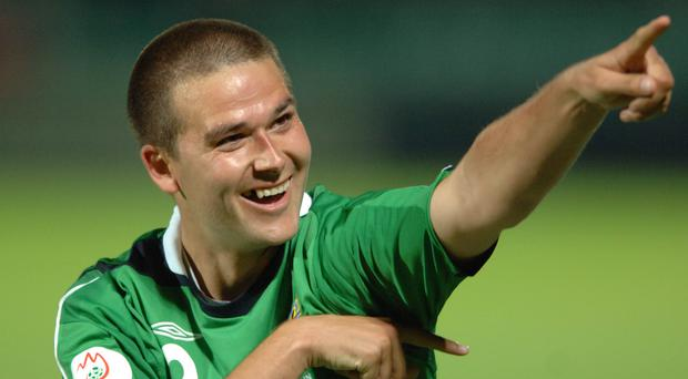 Turning point: David Healy celebrates his famous treble against Spain at Windsor Park.