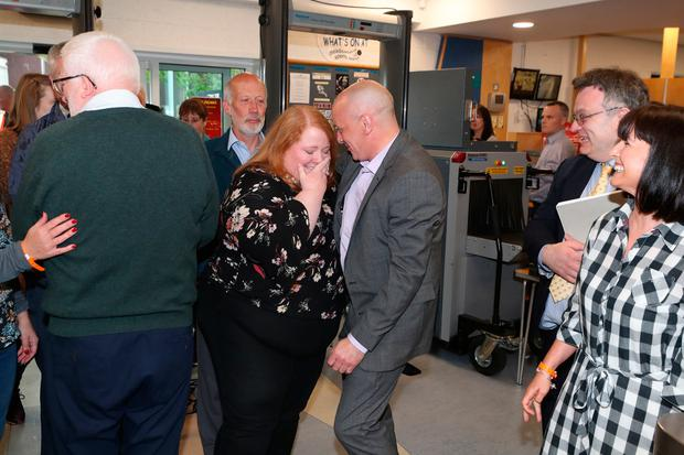 Alliance party leader and candidate Naomi Long (left), being greeted by Alliance MLA John Blair and other colleagues from the alliance party at the European Parliamentary elections count at the Meadowbank Sports Arena in Magherafelt. Photo credit: Liam McBurney/PA Wire