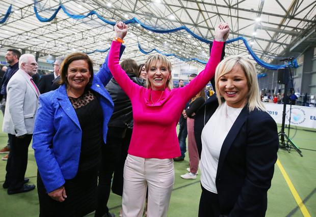 Sinn Fein's Martina Anderson celebrates with party president Mary Lou McDonald and deputy president Michelle O'Neill after she is elected. Picture by Jonathan Porter/PressEye