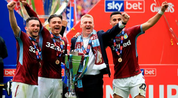 Going up: (from left) John McGinn, Jack Grealish, Dean Smith and Anwar el Ghazi celebrate Aston Villa's win over Derby in the Championship play-off final at Wembley