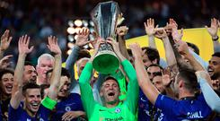 Robert Green holds the Europa League trophy despite not playing a competitive game for the senior side.