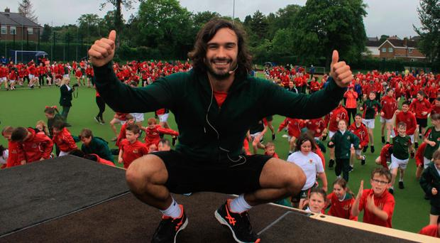 The Body Coach Joe Wicks puts pupils through their paces at Friends Grammar School in Lisburn