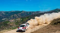 Dust up: Kris Meeke battles the heat to claim third place on day one of Rally Portugal