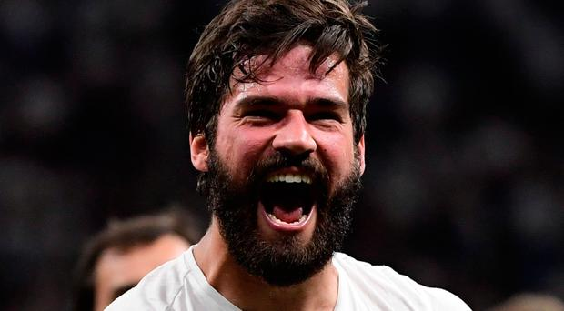 Liverpool's Brazilian goalkeeper Alisson Becker reacts after winning the UEFA Champions League final football match between Liverpool and Tottenham Hotspur at the Wanda Metropolitano Stadium in Madrid on June 1, 2019. (Photo by JAVIER SORIANO / AFP)JAVIER SORIANO/AFP/Getty Images