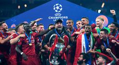 Liverpool manager Jurgen Klopp finally gets his hands on the Champions League trophy.