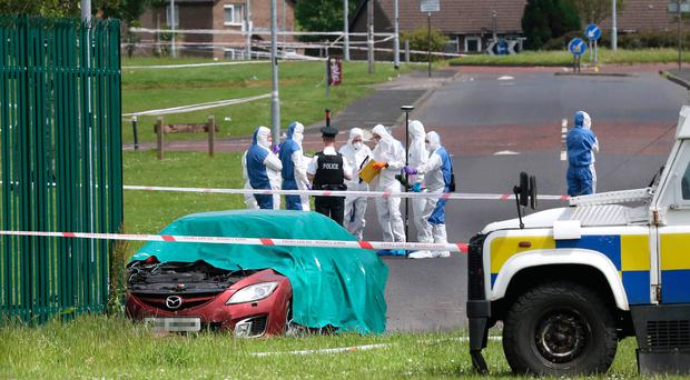 Police and forensics officers at the scene in Galliagh