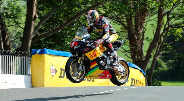 High flyer: Conor Cummins tackles yesterday's Isle of Man TT qualifying session